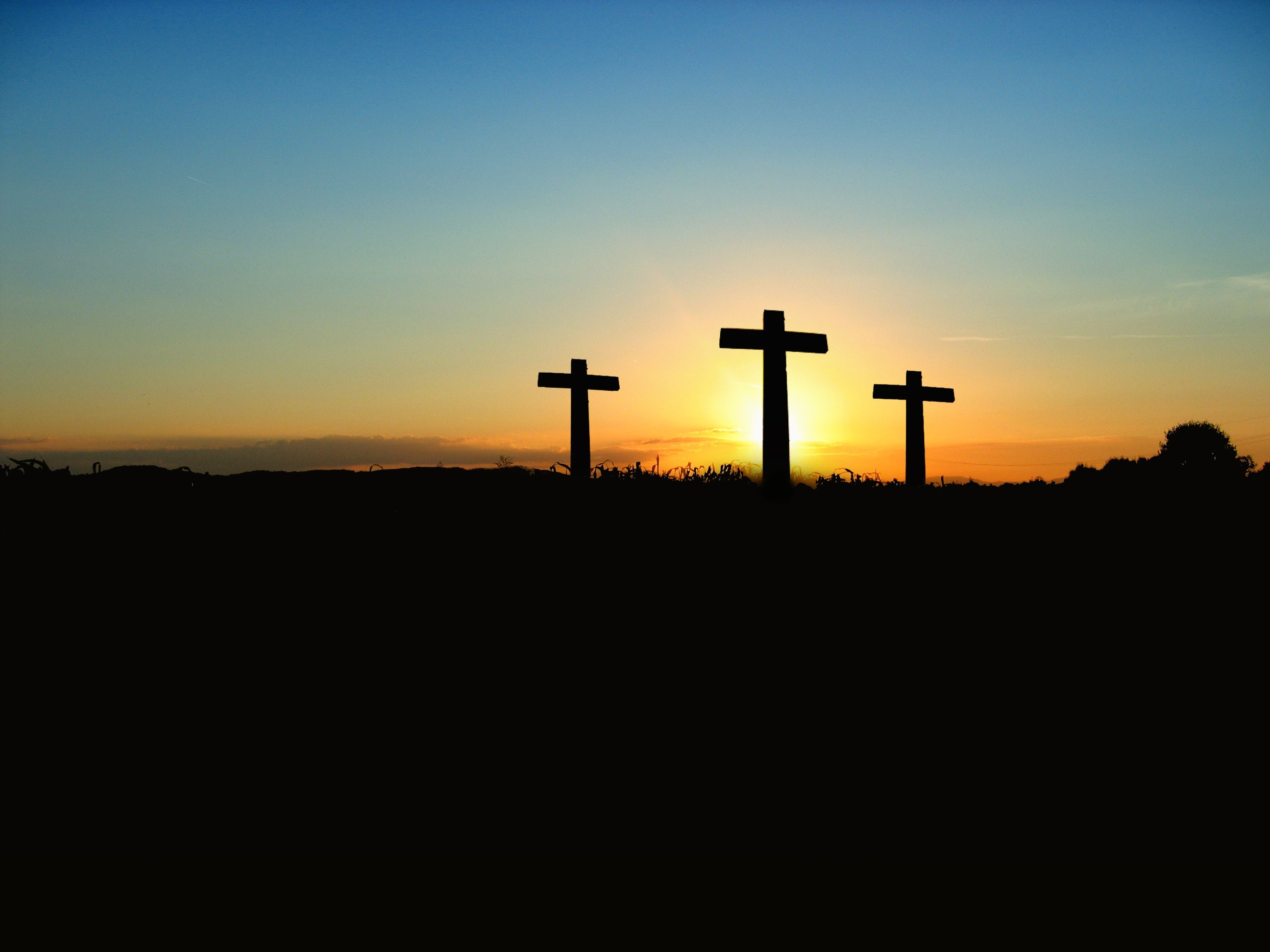 silhouette-photo-of-3-cross-under-the-blue-sky-70847